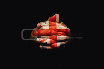 Crossed hands with United kingdom flag