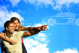 Couple pointing to clouds shaped like a car.