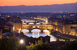 Ponte Vecchio night view over Arno  river in Florence