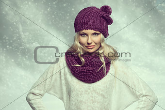 girl in winter dress with cloudy sky behind