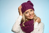 young beautiful blond wearing scarf and winter hat