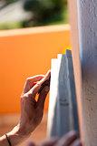 Hand of a woman sanding fixtures