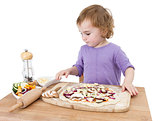 preschooler making fresh pizza