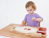 girl making pizza
