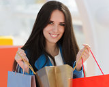 Girl with Shopping Bags Smiling