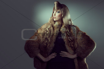 creative fashion portrait of blonde girl