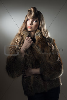 female with warm fur in fashion portrait