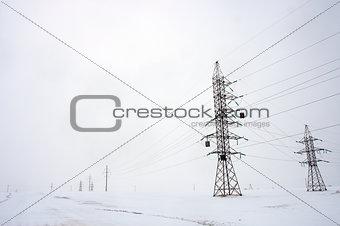 power line near the road in winter