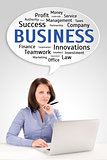 Young business woman is sitting in front of a laptop under speec