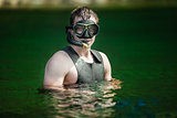 Funny Young Adult Snorkeling in a river