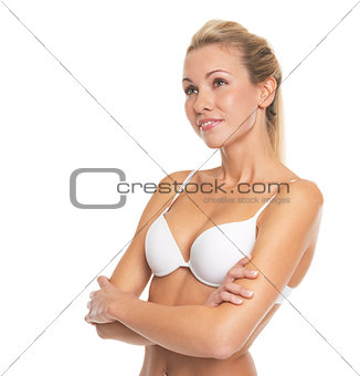 Portrait of thoughtful young woman in lingerie looking on copy s