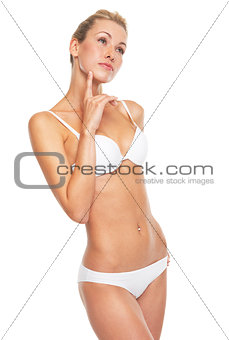 Portrait of thoughtful young woman in lingerie