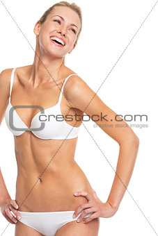 Portrait of smiling young woman in lingerie