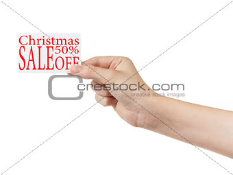 female teen hand holding card with sale promotion words