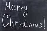 Merry Christmas text on chalkboard