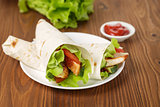wheat tortilla with chicken and vegetables