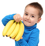 little boy holds bananas