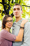 Portrait of love couple outdoor looking happy