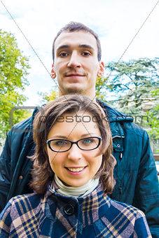 Portrait of love couple  outdoor looking happy