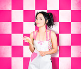Happy young woman cooking with wooden spoon