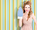 Happy retro housewife holding iron