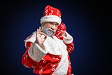 Santa Claus shows OK sign on a dark background
