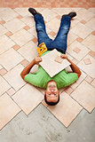 Worker resting on ceramic floor tiles