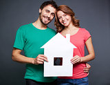 Couple with paper house