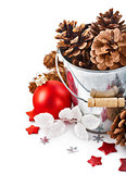 pinecone in bucket with christmas tinsel