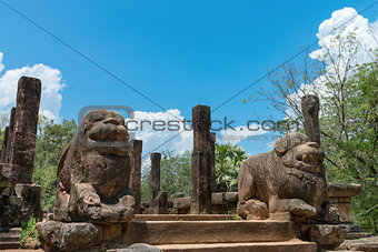 Ancient lion guards near entrance