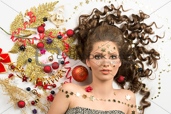beauty christmas girl with creative decorations