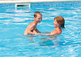 Mother with her son in the pool.