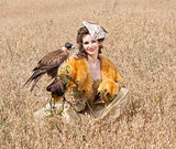 Woman with hawk on hand