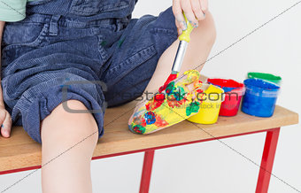 foot of child colorful painted