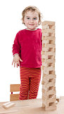 child with tower made of  toy blocks