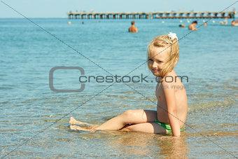 Little girl on the coastal seawater