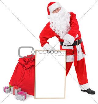Santa claus shows blank white board