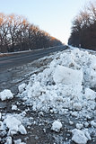 Big snow hummock on the roadside