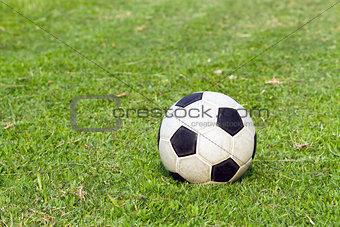football (soccer) on green field