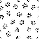 Paw grunge footprint of dog or cat seamless pattern background