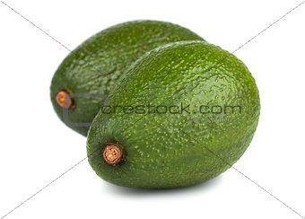 Pair of green ripe avocado