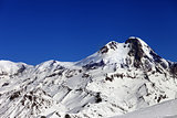 Mount Kazbek at sun winter day