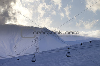 Ski slope and chair-lift in evening