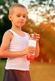 Boy Child caucasian drinking Juice Beverage plastic bottle hot weather summer day outdoor