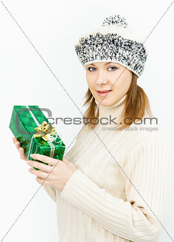 Charming smiling girl holding a gift box