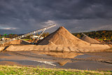Quarry sand on a bank of a river