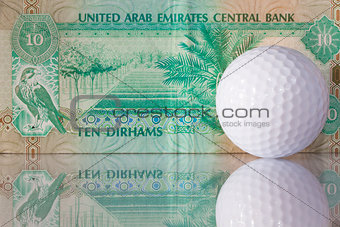 Dirhams and golf ball