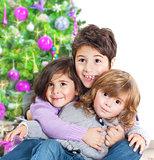 Happy kids near Christmas tree