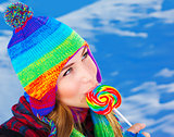 Woman with lollipop outdoors