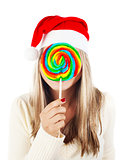 Santa girl eating lollipop